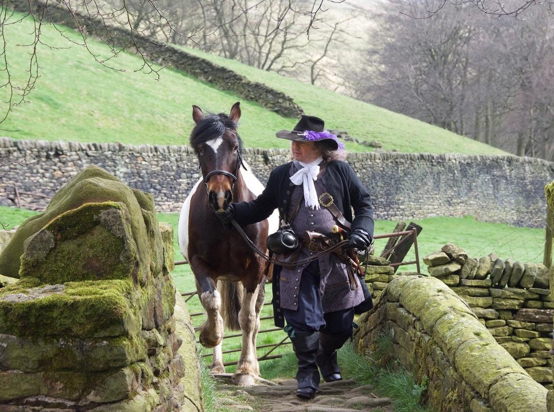 An actor dressed as gentleman highwayman James Hind